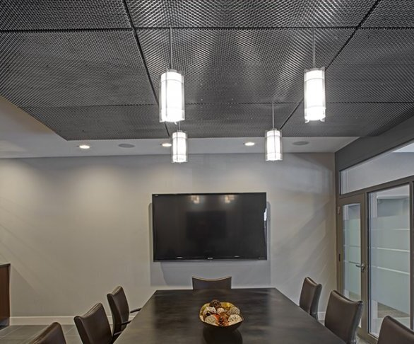 """One of the only challenges seen in this particular project, from design to its installation, was locating the light fixtures and corrective field dimensions. Because GKD's mesh is custom engineered for its applications, it can be bored and trimmed to accommodate lighting, sprinkler, and other fixtures. Commercial Group was left with a """"beautiful and functional ceiling."""""""