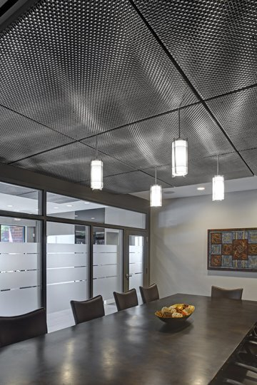 For the conference room, The Commercial Group commissioned GKD to design, manufacture and install a custom metal fabric ceiling.