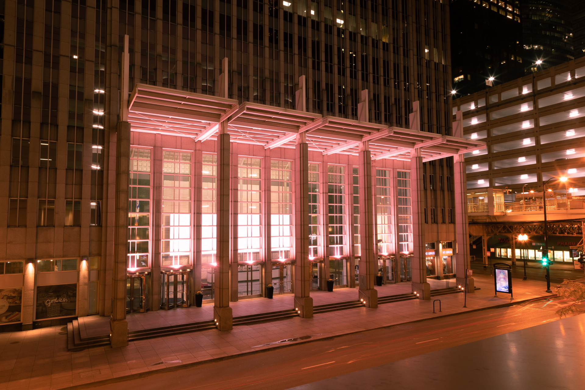 Meteor Lighting's Bolt fixture used in an indirect lighting application to illuminate the large window panes at the 181 W. Madison building