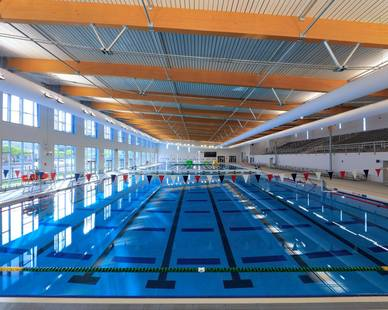 Enjoy the events and space at the CoEP Westside Natatorium in El Paso, Texas, featuring high lumen luminaires by Meteor Lighting.