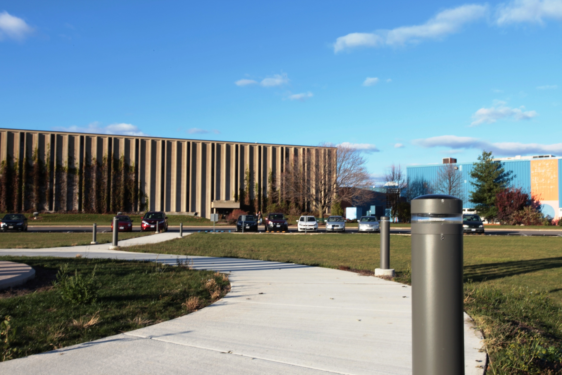 Outside the Fermilab Industrial Building Complex lies a steel structure called Tractricious, that soars 36 feet high. Built to commemorate the new Technical Support building, Meteor's SP-010 solar bollards illuminates its pathways.