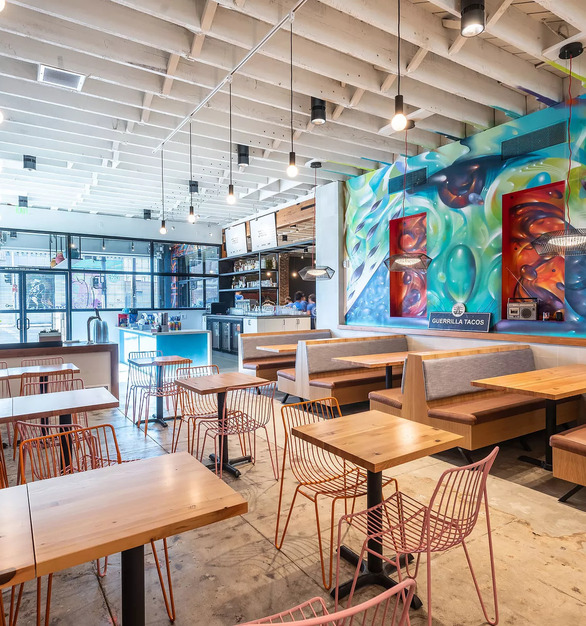 A mix of design elements creates a unique interior at Guerrilla Tacos in Los Angeles, California, featuring Atria 6 high performing light fixtures by Meteor Lighting. Photos by Wonho Frank Lee