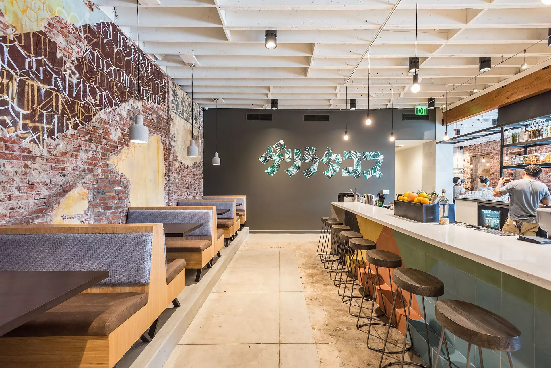 The engaging interior design of Guerrilla Tacos in Los Angeles, California, featuring Atria 6 high performing light fixtures by Meteor Lighting. Photos by Wonho Frank Lee