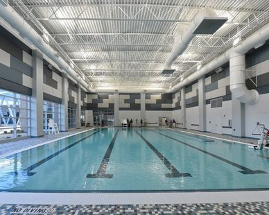 Natatorium rated Bolt Specialty High Bay lighting fixtures used in Huntsville Aquatic Center in Alabama.