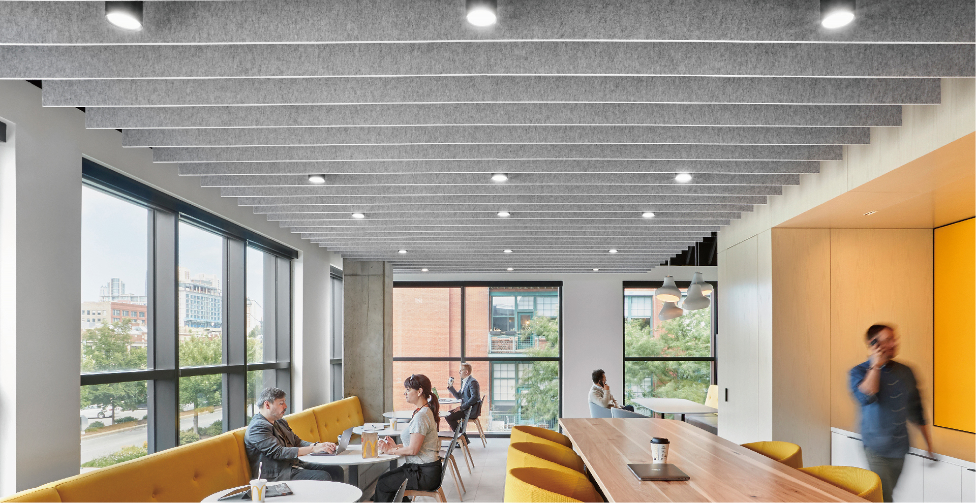 The luminous common area at McDonald's HQ in Chicago, Illinois, featuring Atria 4 architectural indoor luminaire by Meteor Lighting. Photos by Garrett Rowland