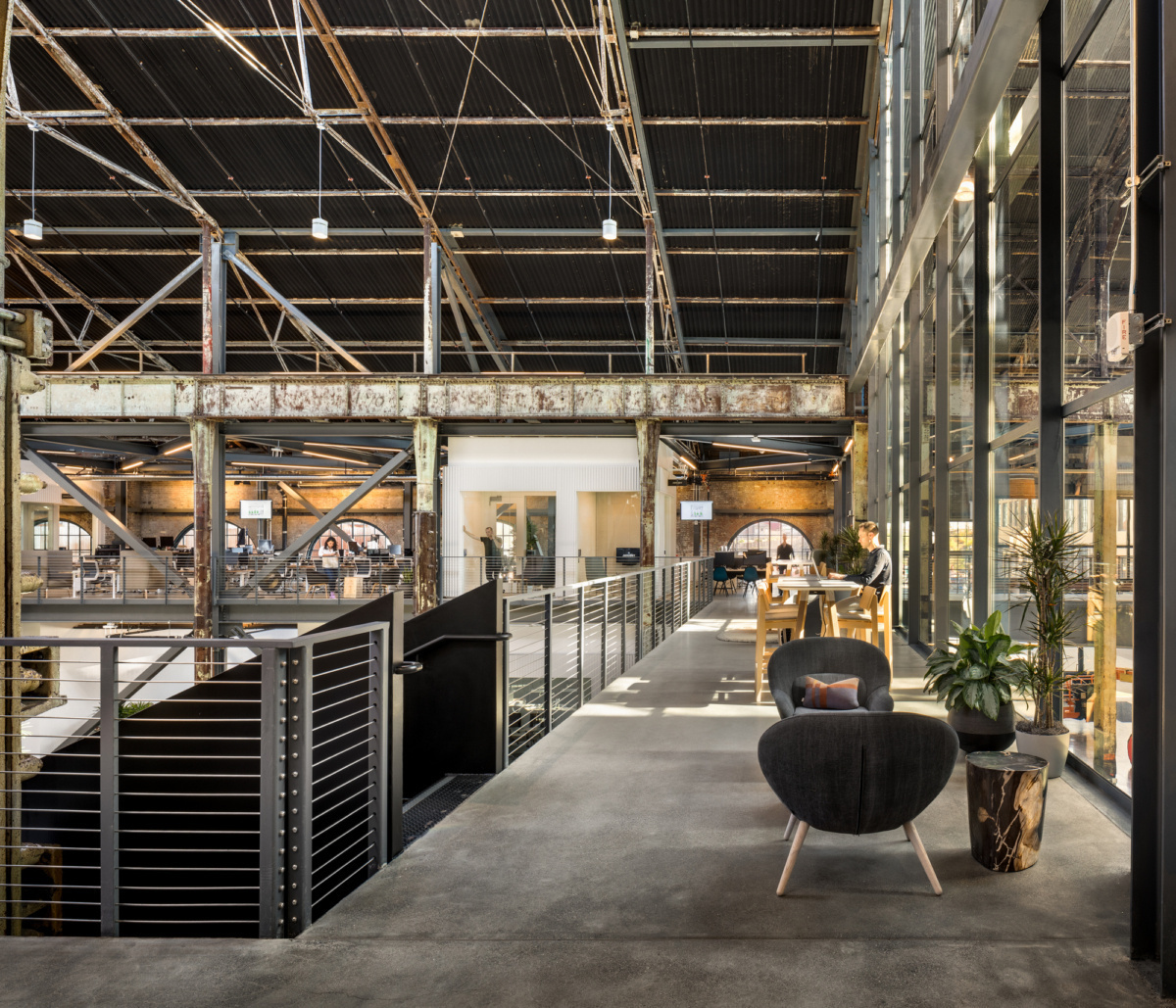 The versatile open space at Gusto's HQ in San Francisco, California, featuring the Signum 10 high bay cylinder by Meteor Lighting.