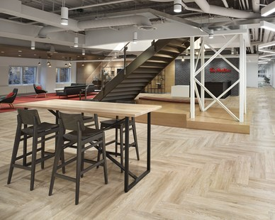 A versatile space for work or community at Tim Hortons headquarters in Toronto, Canada, featuring Atria 4 cylinder light fixtures by Meteor Lighting. Photos by A Frame Inc.