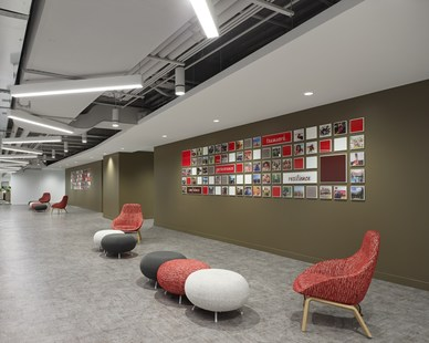 The spacious waiting area for accommodate employees and guests at Tim Hortons headquarters in Toronto, Canada, featuring Atria 4 cylinder light fixtures by Meteor Lighting. Photos by A Frame Inc.