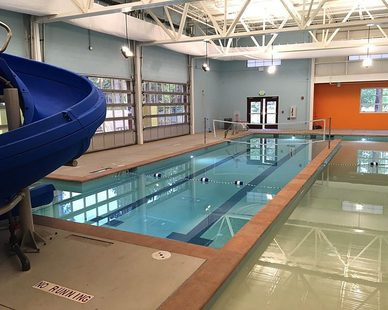 Natatorium rated Tetriss Specialty High Bay lighting fixtures used in Truckee Aquatic Center, California.