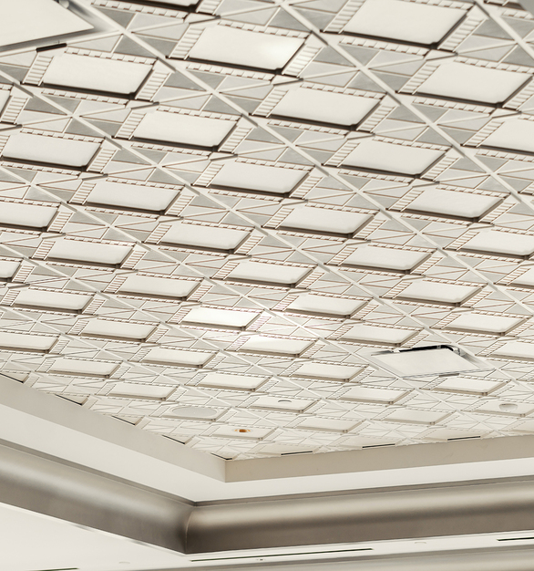 Accommodating everything from intimate meetings to vast exhibitions, the Deco 2 - Square Acoustic Ceiling Tiles promotes a harmonious space at the MGM Conference Center. Each sound absorbing center panel captures indoor noise, while its crisp motif shimmers in an Oyster Pearl finish.