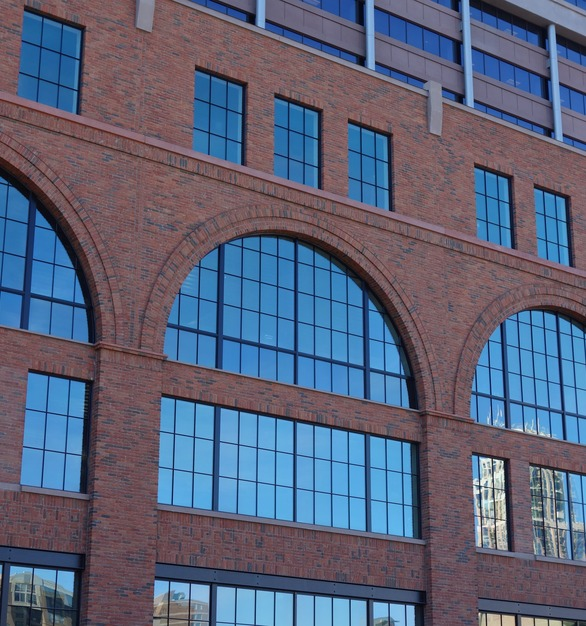 The four-story Millwright Building is new construction, but the historic-looking exterior visually links the building to Minneapolis's historic Mill District.