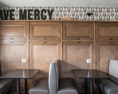 The Downtown Minimalist Double Sconce light sits on the wall of Loyd Have Mercy, complementing the stylish decor of the restaurant.   Available with our full assortment of finish colors — ranging from lively and dynamic to more subdued options — the Downtown coordinates with your personal tastes.