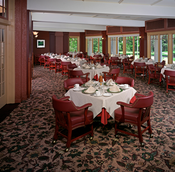 Elegant dining area accented with red chairs provided by Gasser Chairs.