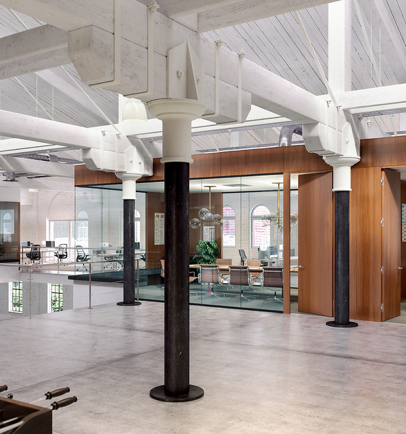Fimo prehung flush wood modules by Modernus complements any architectural glass partitions.