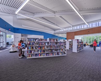 The Shepard Branch Library building is expressed as one large room with large community lounges allowing visual and physical entry and transparency.