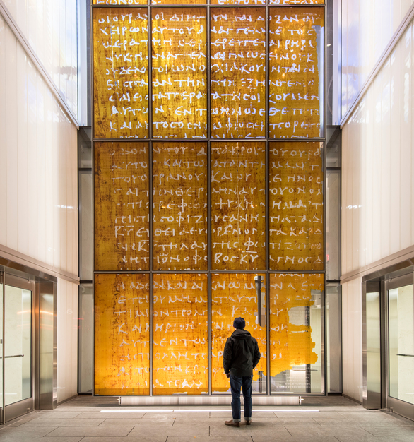 Visitors to the Museum of the Bible are greeted by monumental 22.5-foot tall channel glass walls featuring our Clarissimo texture and a translucent white color frit.   Photo by Alex Fradkin.