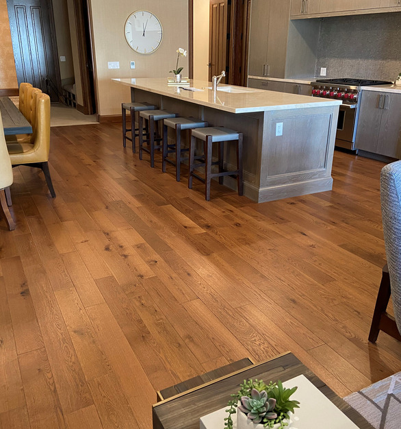 """Flooring from our Legends Collection was chosen for units at this luxury hotel, St. Regis Deer Valley.  The rooms feature our 5"""" Mountain Bay Northern White Oak from our Legends Collection.  Our normal stocking thickness is 1/2"""".  For this particular project, we produced a 5/8"""" thickness so transition from hardwood flooring to tile would remain flush."""