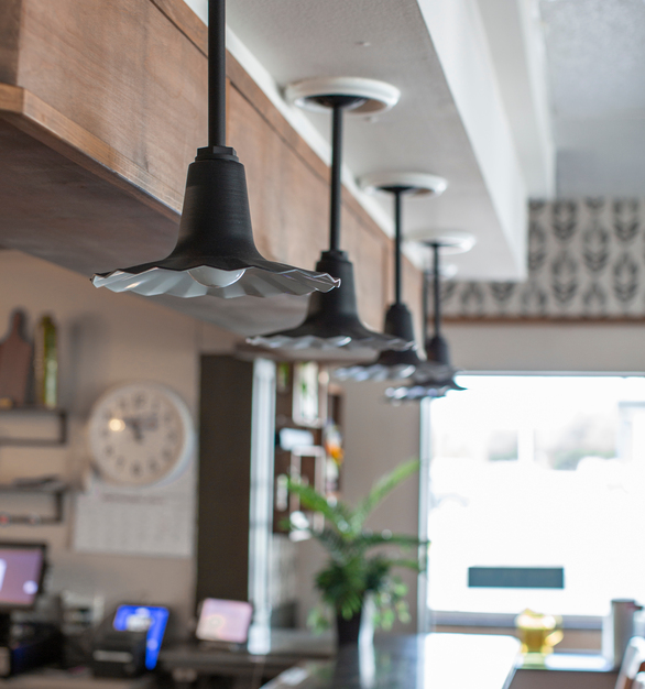 The bar area at Loyd Have Mercy is the perfect place to connect with friends. The Seaside Stem Mount Pendant Light adds to the fun atmosphere of the restaurant.