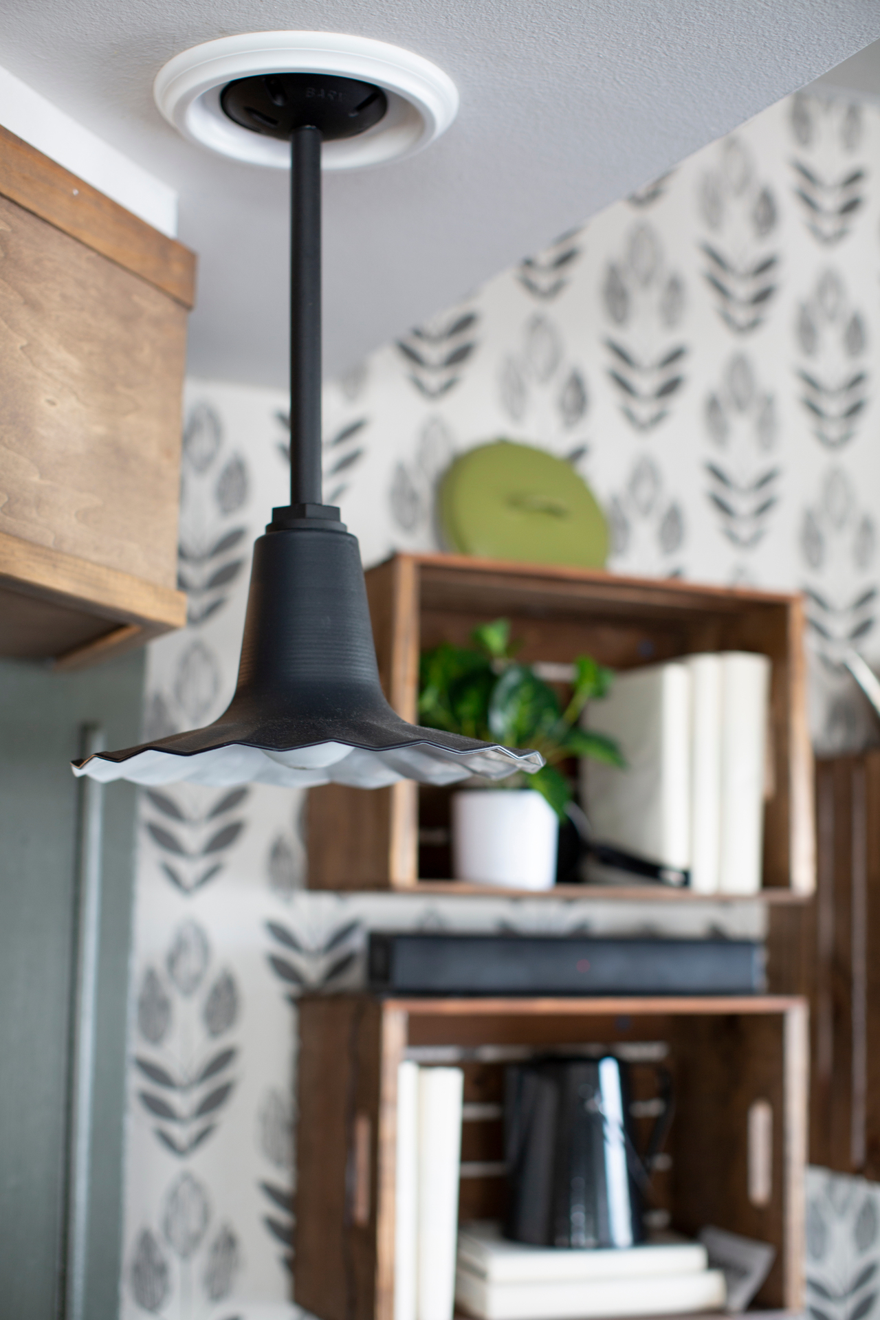 The Seaside Stem Mount Pendant Light is sturdy and durable, while the unique fluted shade adds a classic touch.