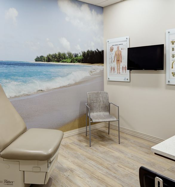 Calm and comforting Hawaiian beach wall mural by Murals Your Way is the perfect addition to any clinic exam room.