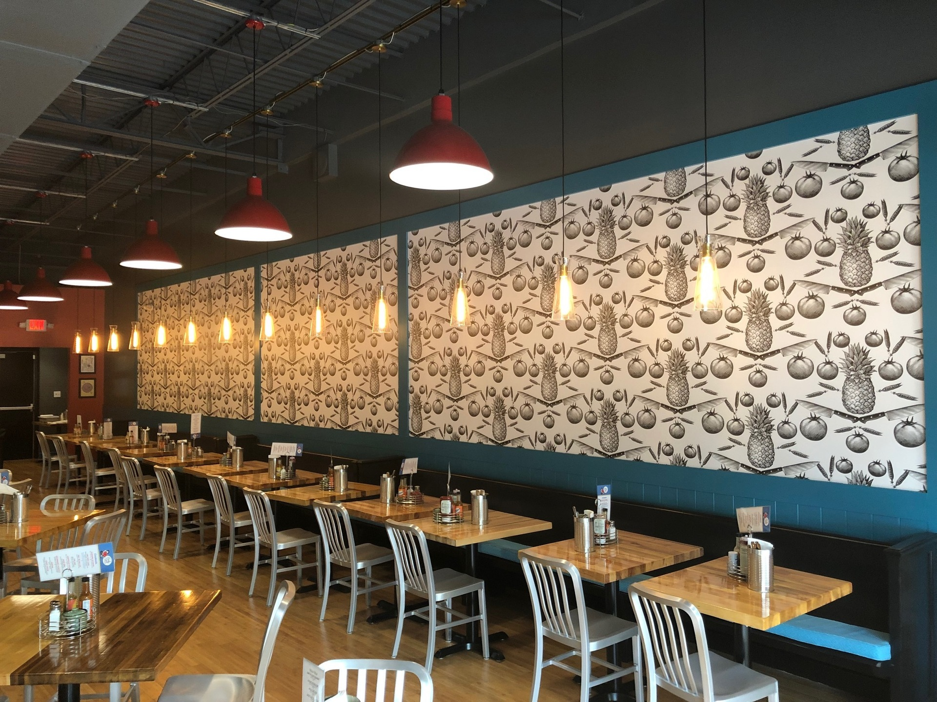 This bar and restaurant features a unique pineapple patterned wallpaper by Murals Your Way, which creates such an amazing conversational piece.