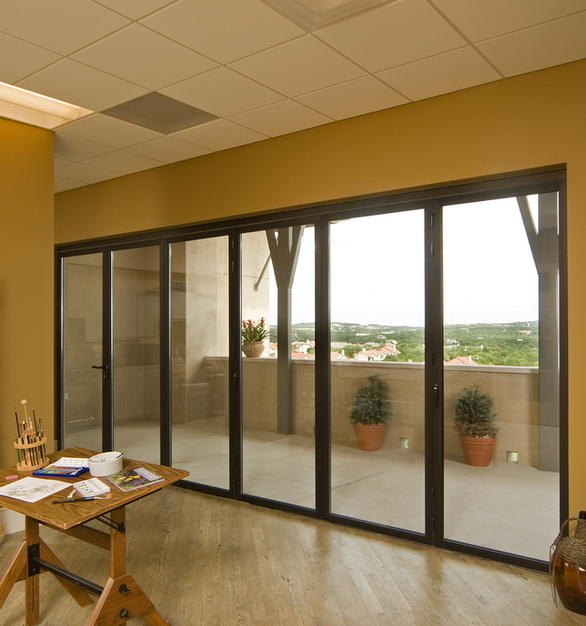 This operable glass wall design proved a perfect choice for the Texas climate, providing insulation during the hot summer months, and transparency at all times.