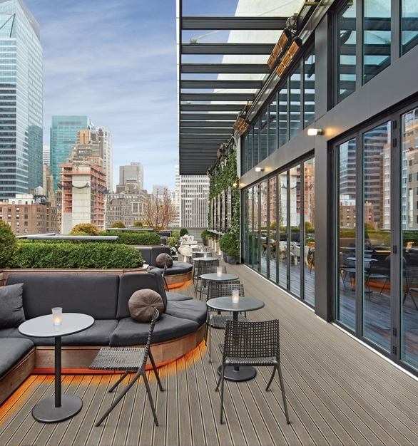 NanaWall SL70 Folding Glass Walls Castell Lounge Restaurant Exterior Rooftop Banquette Seating Recessed Ambient Lighting