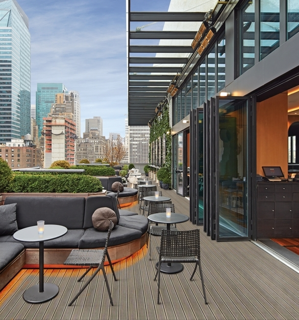 NanaWall SL70 Folding Glass Walls Castell Lounge Restaurant Exterior Rooftop Folded Modular Glass Walls and Guest Seating