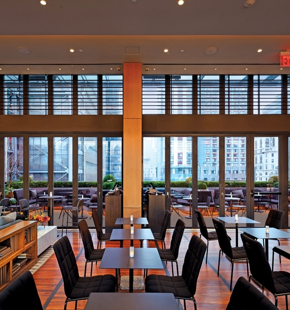 NanaWall SL70 Folding Glass Walls Castell Lounge Restaurant Interior Closed Modular Glass Walls and Guest Seating