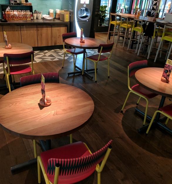 i2i Designs created these round tables tops for Nando's Peri Peri in Chicago, IL
