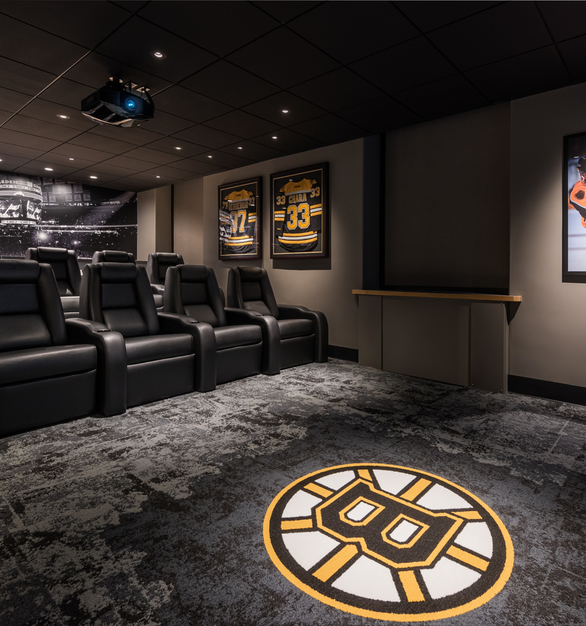 The new Bruins Den is complete with sound-proof walls, stepped reclining seating, a large projector and screen, and automated window treatments that will make guests feel like they are in a mini-movie theater. The room is complete with autographed Bruins memorabilia and custom wall graphics.