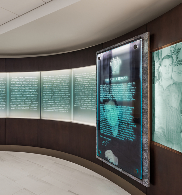 The newly renovated Lobby features a custom-designed marble and glass wall at the entrance of the House with the names of those who made the House a reality and those who continue to support it.