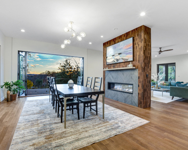 The private residence has a gorgeous wood accent wall for their fireplace and partition wall.