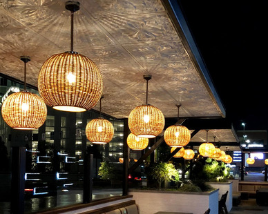 Unwind at the end of the day at this outdoor bar. Admire the gorgeous tin ceiling tiles and hanging lighting.