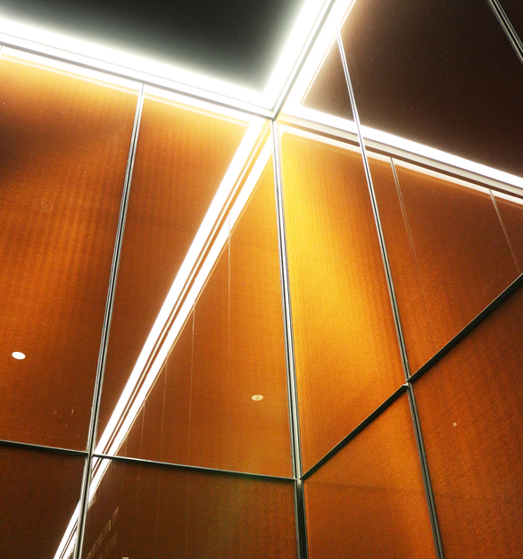 Bendheim's decorative laminated glass offers the highest level of design flexibility and customization. It is available in a wide range of aesthetic options, such as this custom copper-bronze metallic interlayer at the Museum of African American History and Culture. Photo by Anna Lorente.