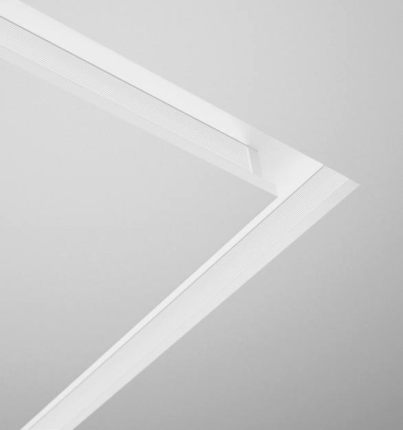 A linear LED recessed luminaire with unique hollow aperture design, Notch 1 adds subtle punctuation of the ceiling plane with very low brightness, color accuracy, high optical and energy performance.  Transparent, vertical Anidolic optical structures with linear light extraction elements deliver optical precision and control, balancing occupant comfort with high performance and value.