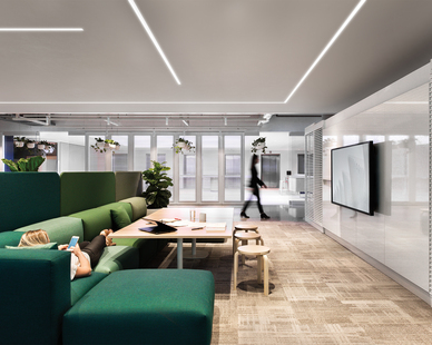 Open office, breakout area. Lighting: Notch 1 recessed linear luminaires by Fluxwerx.