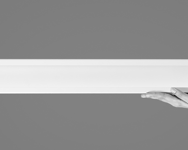 """Notch is an innovative, high-performance, recessed LED luminaire for the general lighting of commercial, institutional, retail and civic spaces.  A true 'slot' product that creates a luminous slot in the ceiling instead of the standard stripe, Notch reinvents the category by extruding the recessed slot to the face of the vertical drywall with the revolutionary Dado end option.  Notch delivers exceptional performance with the integration of Fluxwerx Anidolic Extraction optics to provide precisely controlled optical distributions with no view of the LED point source – up to 12' o.c. spacing delivering 35 fc @ 0.33 W/ft2.  Notch is available in continuous runs or standalone fixtures. Run lengths in 1ft increments in drywall and 2ft increments in t-bar ceilings (on-grid). Standalone fixtures are 2ft, 3ft, 4ft, or 8ft and as a 2ft x 2ft L-shaped standalone corner.  Symmetric and asymmetric area distributions and vertical surfaces illumination (VSI) distributions in both symmetric and asymmetric for library stacks and retail shelving Available in various open and closed patterns in all distributions for drywall or grid ceilings.  Notch is available in a variety of drywall options with extruded aluminum trim designs for trim, trimless and two unique mud-in drop trim options for precise fit and finish. Grid ceiling options include 15/16', 9/16' flat-T, 9/16' tegular as well as compatibility with 4"""" Armstrong® Techzone® or 4"""" USG® Logix ceiling systems.   Winner of Good Design product design award 2017."""