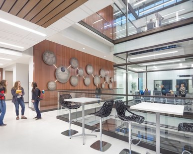 Interior glassing, glass, and bright white wall are the main features that can be found throughout the Jack and Mary Dewitt Family Science Center at Northwestern College in Orange County, Iowa.