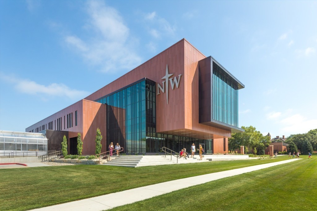 The Jack and Mary Dewitt Family Science Center at Northwestern College in Orange County, Iowa features two expansive curtain walls with a modern aluminum rain screen.