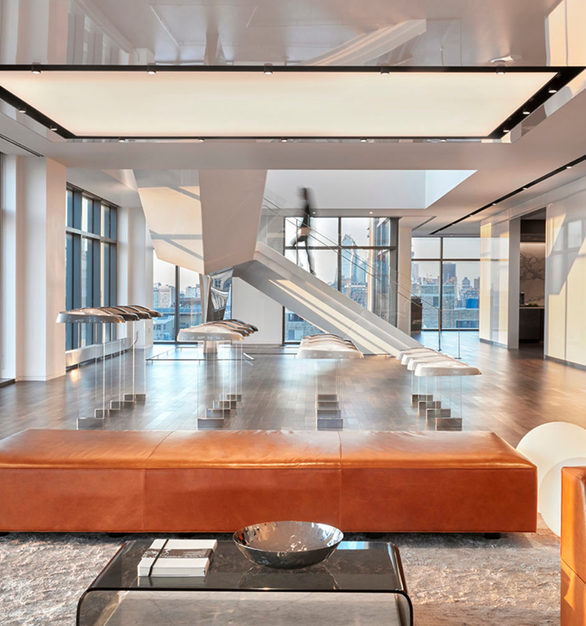 The spacious lobby at Cadillac's office headquarters in New York City, New York, featuring Walnut Steel Gray flooring by Nydree Flooring.