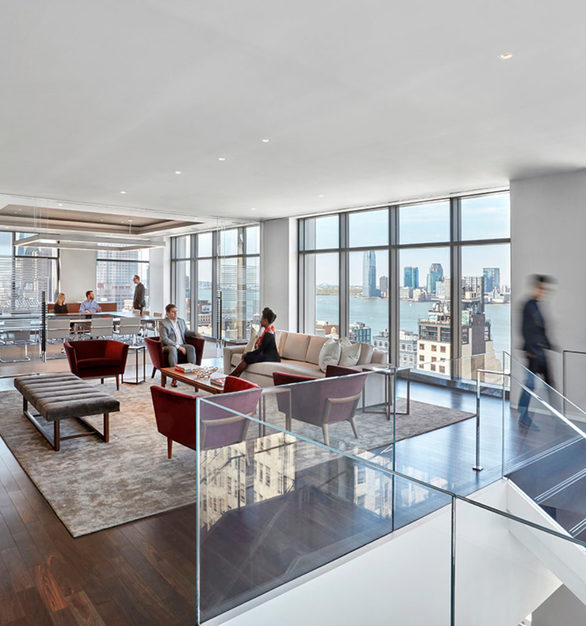 The open concept office design at Cadillac's office headquarters in New York City, New York, featuring Walnut Steel Gray flooring by Nydree Flooring.