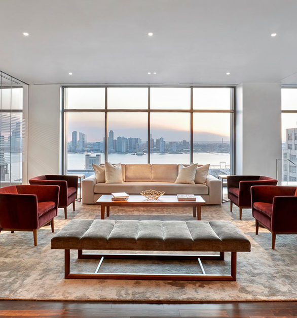 The comfortable lounge area with a view at Cadillac's office headquarters in New York City, New York, featuring Walnut Steel Gray flooring by Nydree Flooring.