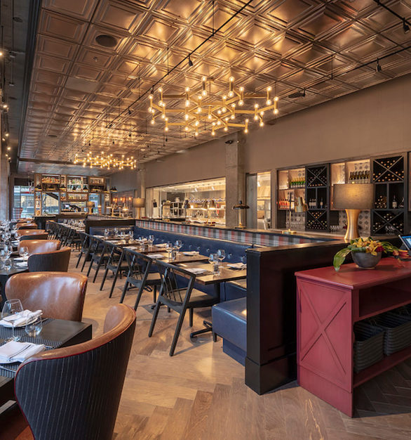 A variety of options to enjoy the decor and interior of Camden Spit & Larder in Sacramento, California, featuring Maple Hardwood City Fog Flooring by Nydree Flooring.