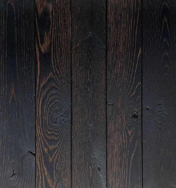 Shou Sugi Ban Oak Toasted by Pioneer Millworks. Charred wood paneling that is burned, brushed once, and coated with an exterior oil