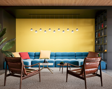 A vibrant and cozy lounge area with unique lighting featuring the Glowball™ from OCL. This pendant comes in a variety of configurations and can complement any themed design.