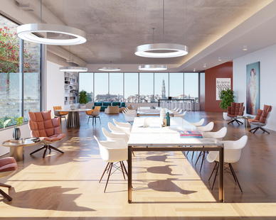 An open office layout with a view of the city featuring OCL's Glowring™ Pendant and Fiori™ lighting fixtures. Because they're LED's, they provide top-tier energy efficiency.
