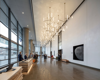 Elegant decorative fixtures, including a custom chandelier in the main lobby, elevate the feel of public spaces for visitors and guests to enjoy.