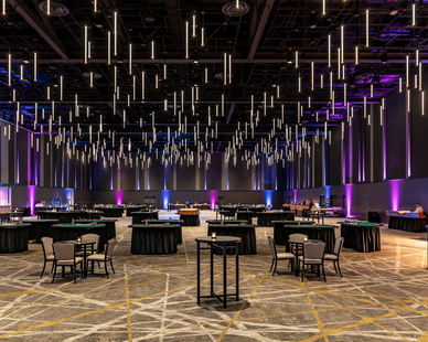 The event center features tunable RGB lighting and custom suspended ceiling lighting provided by OCL.