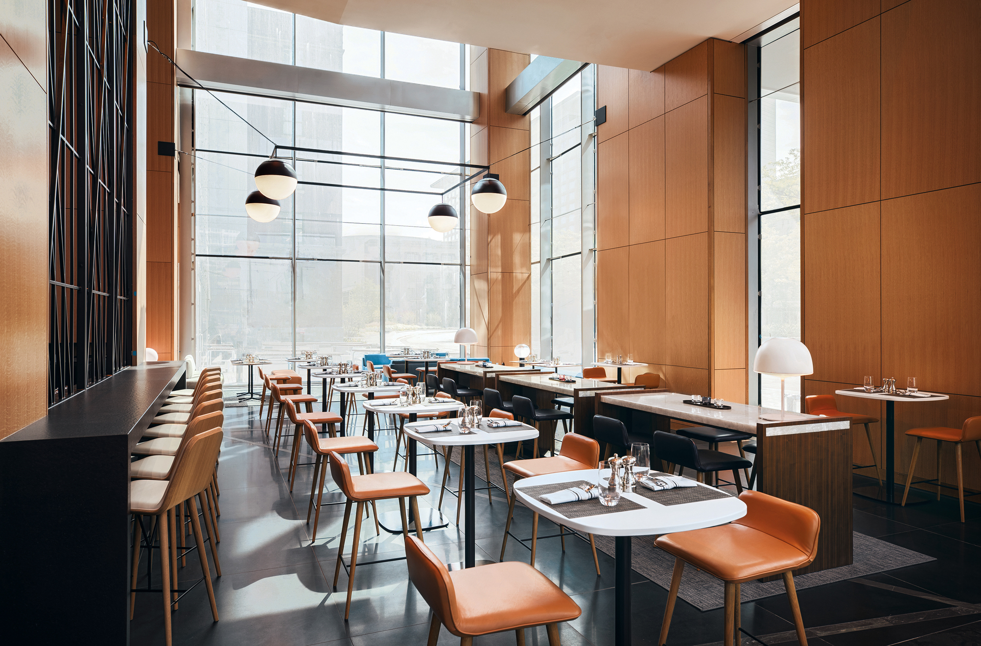 Woven & Bound, the Marquis' restaurant (paying homage to the history of American Book Co. with its name) transitions seamlessly from 2121 Pantry, with expansive space and warm, welcoming light from bespoke globe pendants by OCL. The pendants are also seen from Prairie Avenue via the hotel's tall glass paneling.
